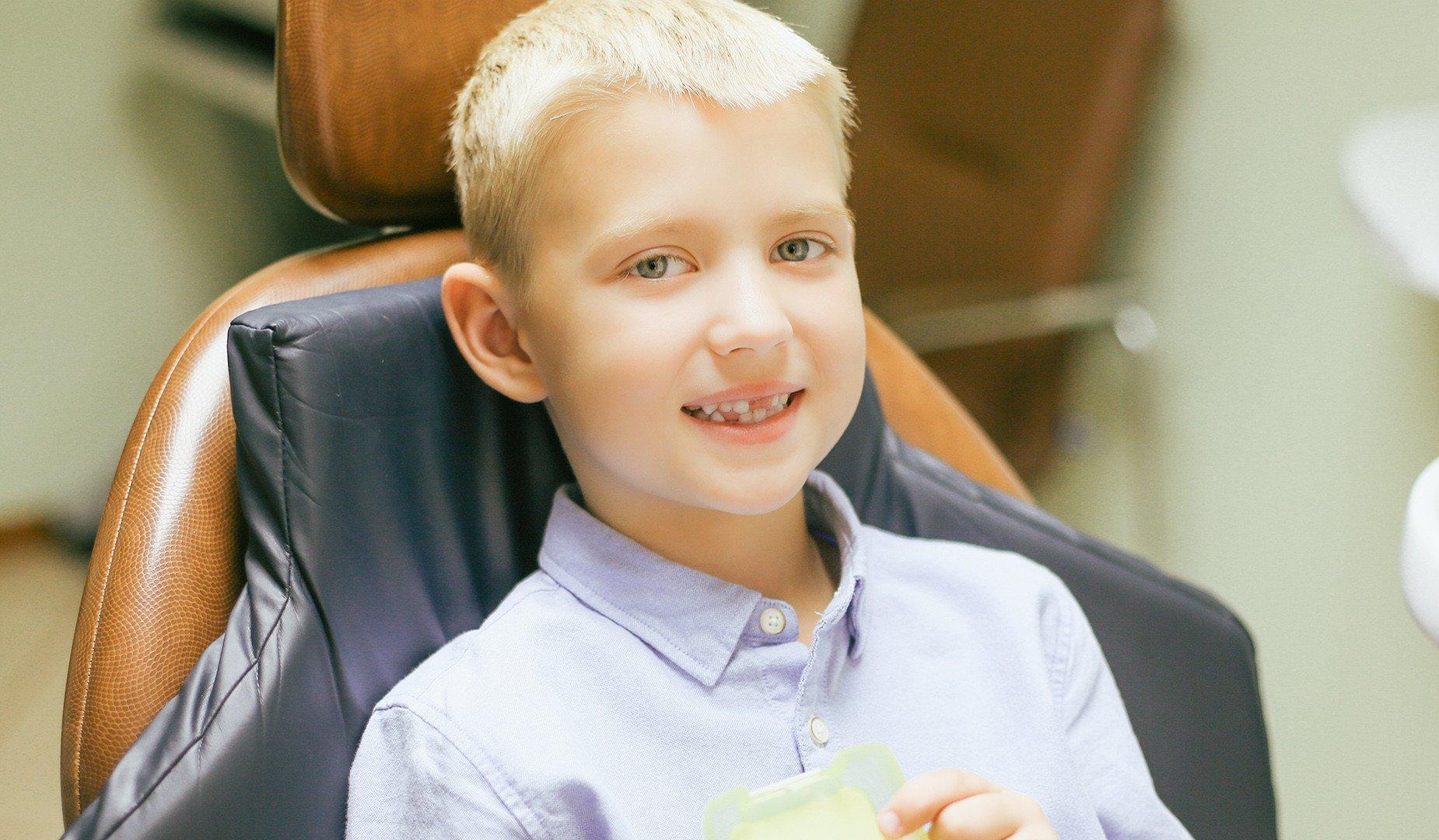 Счастливая улыбка маленького пациента