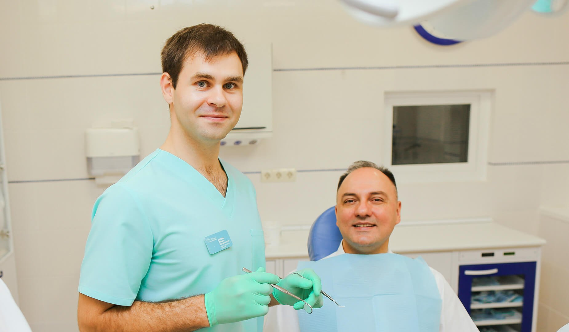 Пациент с врачом-ортопедом